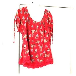 Red floral blouse with ruffled neckline and ties